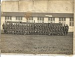 "Photograph taken on April 3rd, 1918, showing ""80 C.T.S. R.A.F. Camp Taliaferro, Field No. 2, Ft. Worth, Texas"". The squadron is lined up in front of an aircraft, with a hangar behind that. Fort Worth (6079345185).jpg"