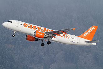 Innsbruck Airport - An easyJet Airbus A320-200 departing Innsbruck, with surrounding mountains in the background