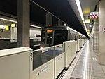 Platform of Fujisaki Station and train for Fukuoka Airport Station.jpg