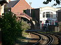 Poole High Street level crossing - viewed from station 2005-07-16, barriers down.jpg