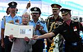 Pranab Mukherjee releasing a commemorative postage stamp at the presentation ceremony of the President's Standard and Colours to 119 Helicopter Unit, 28 Equipment Depot, at Air Force Station, Jamnagar, in Gujarat.jpg