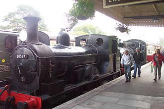 LSWR 0298 Class - Both preserved members of the LSWR 0298 class working a train into Bodmin General station on the Bodmin and Wenford Railway in October 2010.