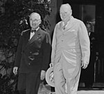 "President Truman and Prime Minister Winston Churchill leave the ""Little White House,"" the residence of President... - NARA - 198763 (cropped).jpg"