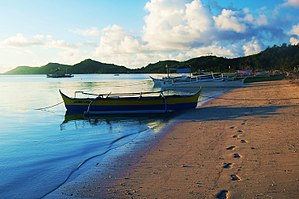 Suluan - Pristine blue sea and the sand turns to gold on the scorching heat of the sun.