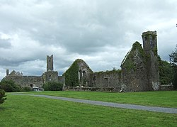 The ruins of the former parish church, with Quin Abbey beyond