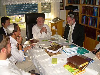 Dov Lior - Rabbi Dov Lior (center) in a meeting with students of Machon Meir at his house in Kiryat Arba in June 2008