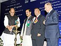 """Rajnath Singh lighting the lamp at the launch of the """"Tourist Visa on Arrival enabled by Electronic Travel Authorization (ETA)"""", in New Delhi. The Minister of State for Culture (Independent Charge).jpg"""