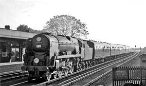 Raynes Park railway station - Plymouth - Waterloo express passing in 1964
