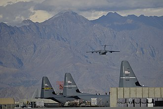 455th Air Expeditionary Wing - A C-17 Globemaster III takes off from Bagram Airfield near C-130 Hercules deployed with the wing