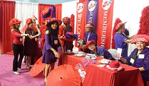 Red Hat Society - The Red Hat Society booth at the AARP convention in Miami in 2015.