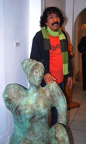 Vladimir Cora - Cora with one of his sculptures at a 2013 exhibition