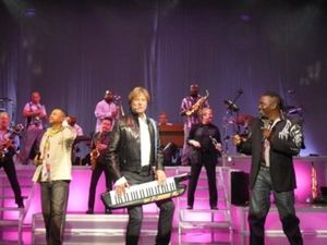 Robert Lamm - Robert Lamm (center) performing with Earth, Wind & Fire on keytar.