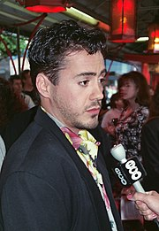 Robert Downey Jr. facing right in 1990 at a film premiere for his movie Air America
