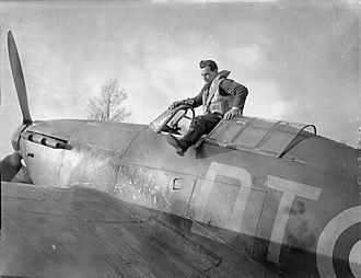 "Howard Peter Blatchford - Flight Lieutenant H P ""Cowboy"" Blatchford of No. 257 Squadron RAF climbing out of his Hawker Hurricane Mark I at RAF Martlesham Heath, Suffolk."