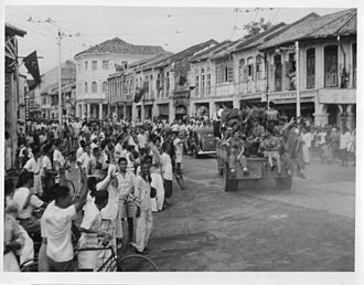 Operation Jurist - Royal Marine commandos on confiscated Japanese vehicles in George Town on 3 September 1945.