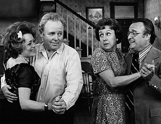 "Rue McClanahan - On a 1972 episode of All in the Family, ""The Bunkers and the Swingers"", L-R: Rue McClanahan, Carroll O'Connor, Jean Stapleton and Vincent Gardenia"