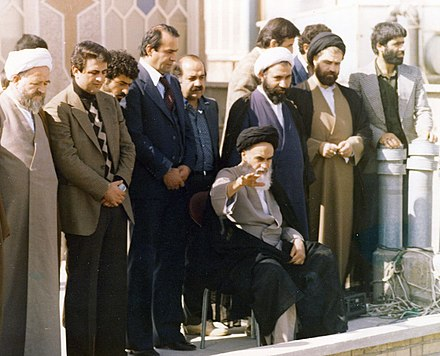 Ruhollah Khomeini rose to power after the Iranian Revolution. Ruhollah Khomeini on the roof of his residence, Qom.jpg