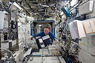 STS-134 Roberto Vittori floats through the Destiny lab
