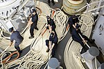 Sailors aboard USS Iwo Jima heave mooring lines during a sea-and-anchor detail. (30386553420).jpg