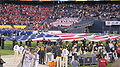 Sailors display American flag at 2009 Poinsettia Bowl.JPG