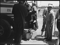 San Bruno, California. Arriving at the Assembly center, the man at the right is a volunteer Japanes . . . - NARA - 537483.tif