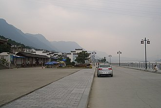 Sandouping - On the Yangtze waterfront near Sandouping town center (Huanglingmiao Village), looking west toward Xiling Bridge and the Three Gorges Dam (not visible because of fog)