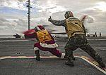 Santa Claus gives the signal to launch a T-45C Goshawk. (30788666343).jpg