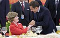 Sarkozy greets Laura Bush.jpg