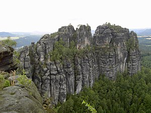 Geology of Germany - Left: Outcropping beds of White Jurassic limestone at the edge of the landslide at Hirschkopf near Mössingen (Swabian Jura). Right: The Schrammsteine, Late Cretaceous sandstones in the Elbe Sandstone Mountains near Bad Schandau.