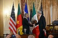 Secretary Kerry Shakes Hands With CEO Kannappan of Plantronics, Inc. (12207829173).jpg