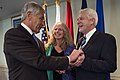 Secretary of Defense Chuck Hagel gives his coin to Lee and Ray Kapaun at the Pentagon, April 12, 2013.jpg