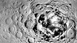 SELENE - Map of the lunar south pole showing the SELENE craft at the left.