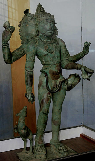 Bhikshatana - A 12th-century bronze Bhikshtana in the Nayak Palace Art Museum, Thanjavur. Like many other bronzes, the separately-cast trishula is missing from the hand.