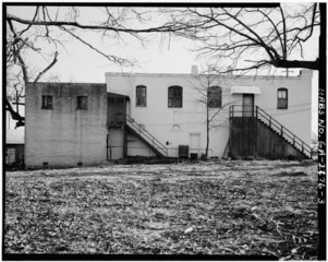 File:Side view, elevation of storefront-apartment building ...