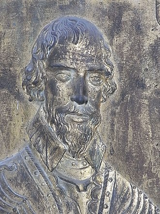 John Wyndham (1558–1645) - Sir John Wyndham, gilt-bronze cast relief plaque, on his purbeck marble slab, east wall of north aisle, St Decuman's Church, Watchet, Somerset