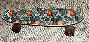 1970s Surfer print fiberglass skateboard