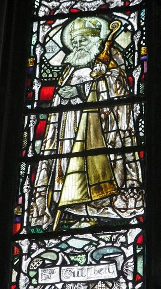 Cuthbert - Stained glass depicting St Cuthbert of Lindisfarne, from Gloucester Cathedral.