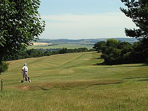 Streatley, Berkshire - Part of Golf Club course and agricultural and wooded hills with footpaths in background.