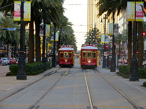 Canal Street, New Orleans - Streetcars on Canal Street, looking toward the river at Bourbon Street, May 2013