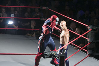 Suicide (wrestling) - Suicide (portrayed by Kazarian) posing above Daniels, who once used the gimmick.