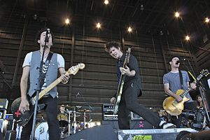 Sum 41 - Sum 41 performing on Vans Warped Tour in 2010. From left to right: Deryck Whibley, Steve Jocz (back), Jason McCaslin, and Tom Thacker