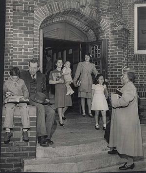 Sumner Library - The variety of patrons is evident in this 1943 photo of Sumner Library's entrance.