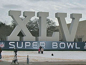 An oversized marquee for Super Bowl XLV outsid...