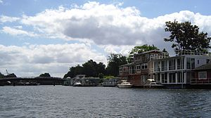 Tagg's Island - Tagg's Island from upstream with large houseboats and the road bridge to the island