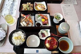 Japanese cuisine - A Japanese meal including tempura, sashimi, and miso soup