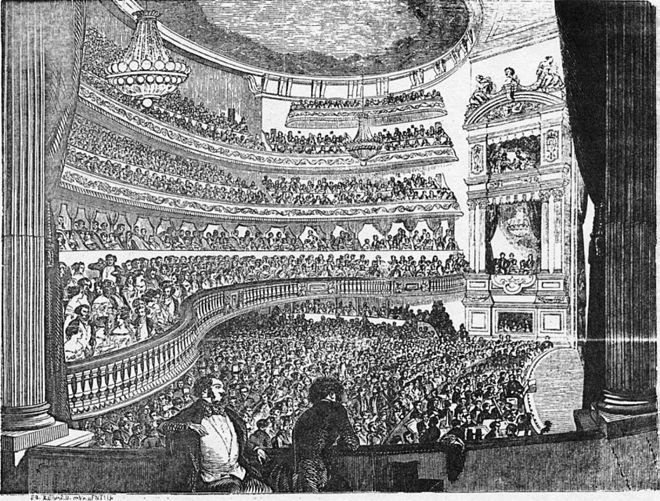 View of the auditorium from the a stage box showing the two chandeliers Theatre Historique - interior - Chauveau 1999 p373.jpg