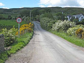 Republic of Ireland–United Kingdom border - The border at Killeen (viewed from the UK side) marked only by a metric (km/h) speed limit sign