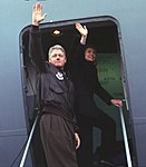 The Clintons wave from the doorway of The Spirit of Bob Hope airplane on departing from Sarajevo en route to Tuzla - Flickr - The Central Intelligence Agency (cropped).jpg