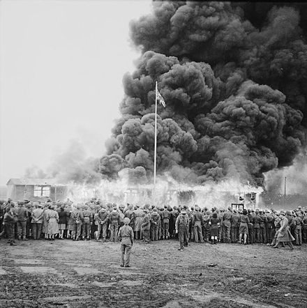 A crowd watches the destruction of the last camp hut The Liberation of Bergen-belsen Concentration Camp, May 1945 BU6674.jpg