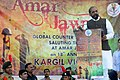 The Minister of State for Home Affairs, Shri Hansraj Gangaram Ahir addressing during the Kargil Vijay Diwas programme, organised by the Global Counter Terrorism Council, at the Amar Jawan Jyoti, India Gate, in New Delhi.jpg